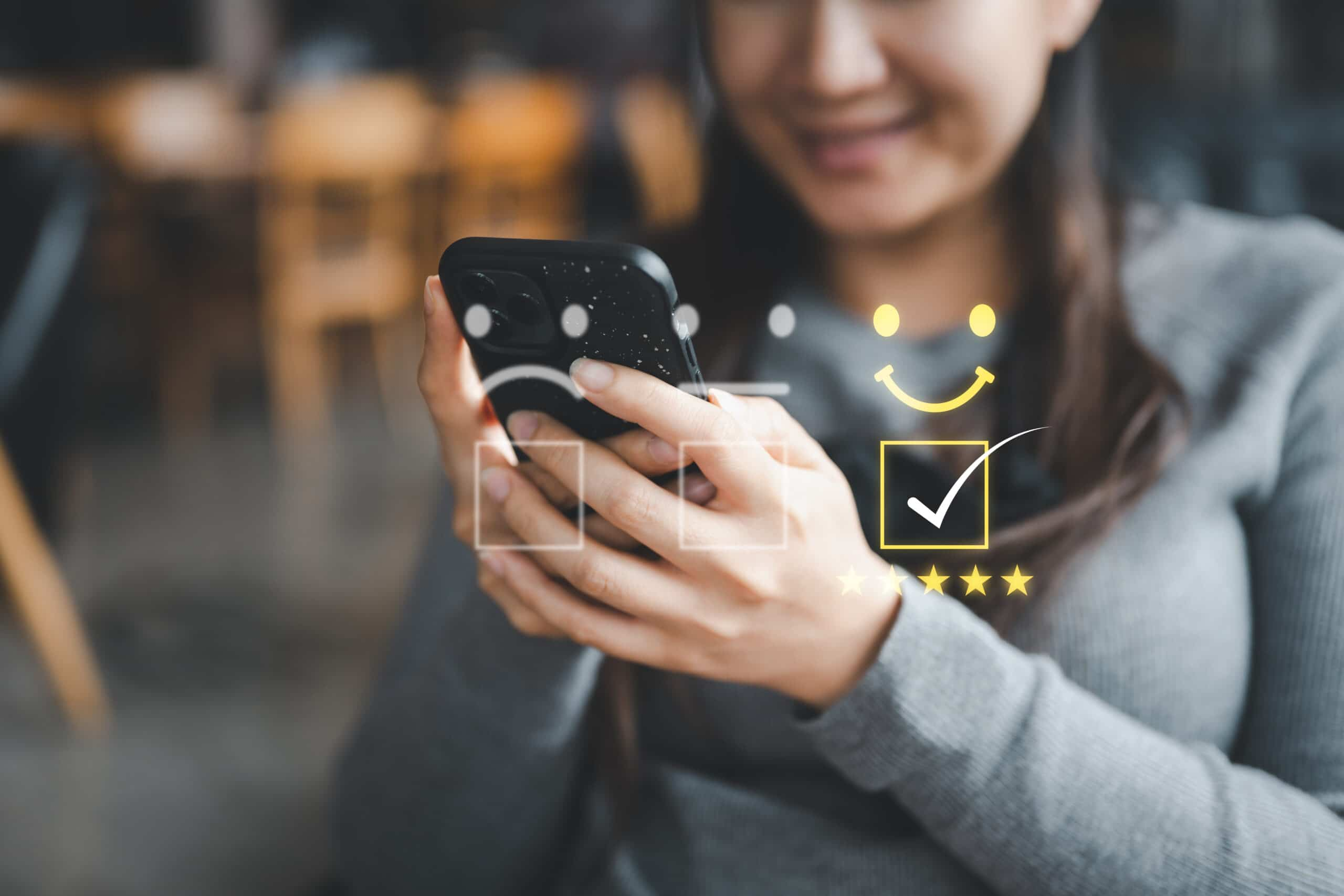 Customer service evaluation - a customer evaluates her contact centre experience on her smartphone