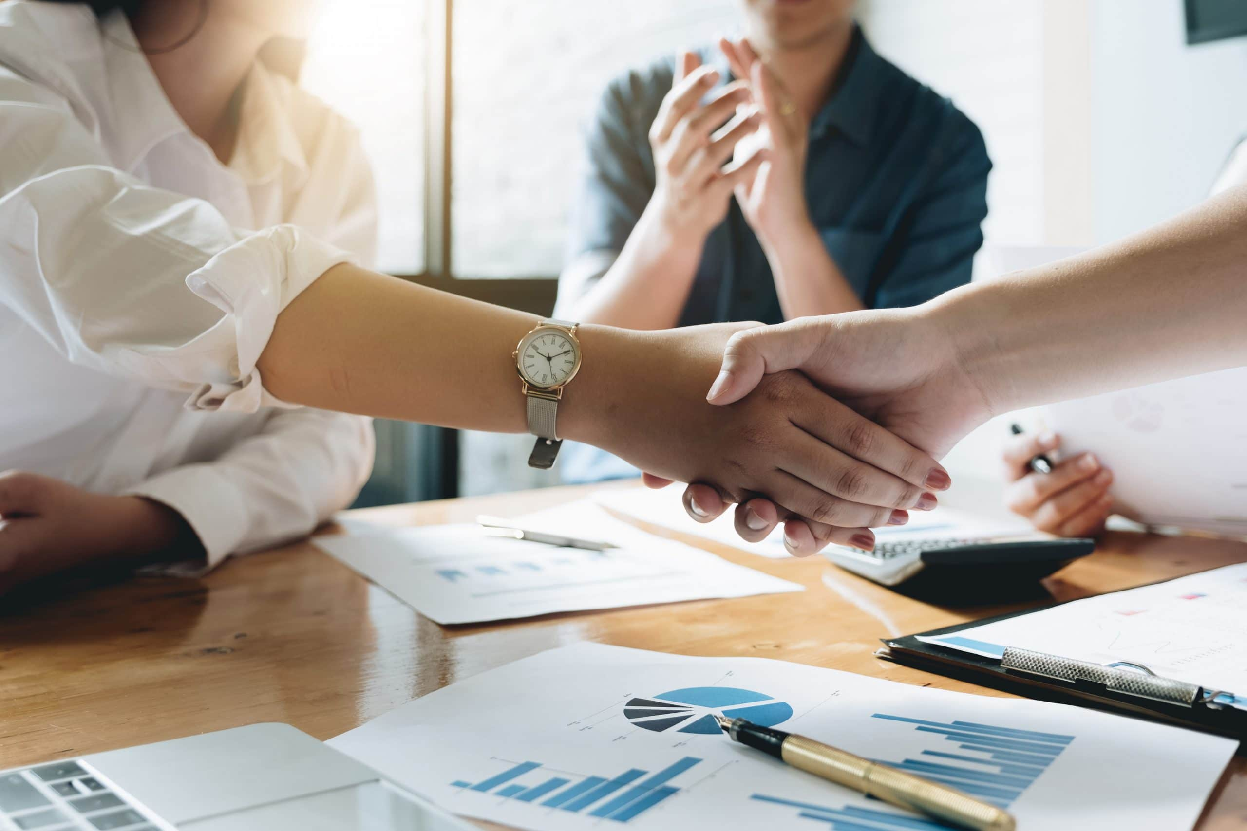 Close up of Business people shaking hands, finishing up meeting, business etiquette, congratulation, post merger integration and acquisition concept