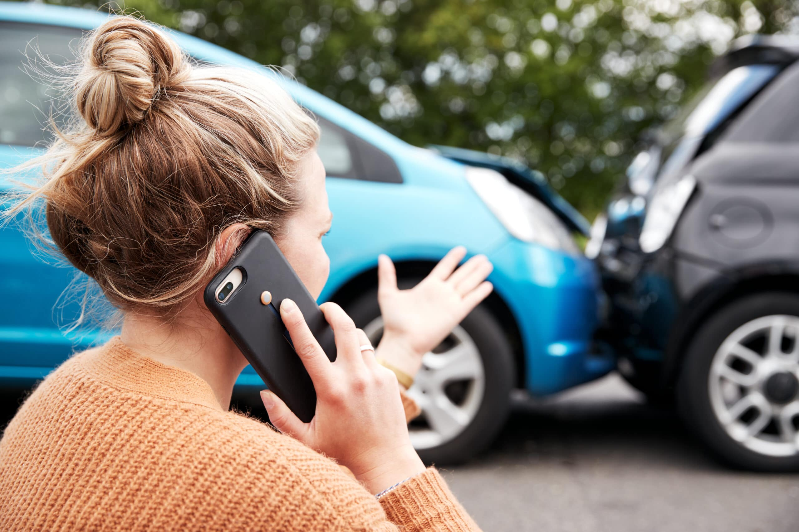 Female Motorist Involved In Car Accident Calling Insurance Company to Make a Claim